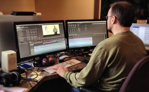 This guy is definitely using the best video editing software since he has three screens, right?