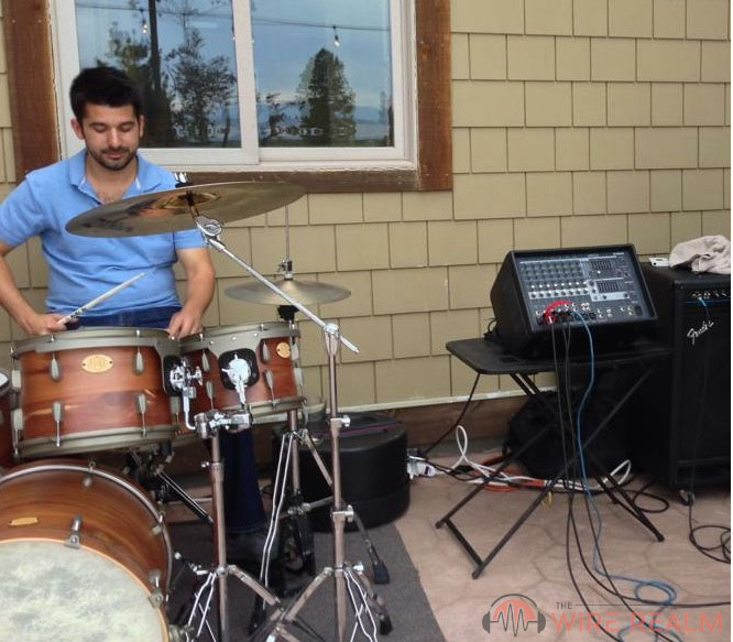 A drummer with a live performance mixer