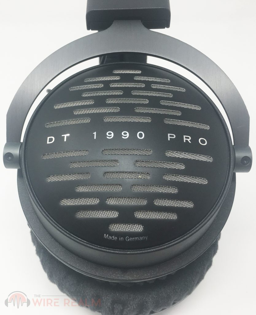 A close-up of the open-back ear cups of the DT 1990 PRO